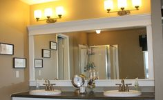 I love framed mirrors in the bathroom but I really don't like the idea of ripping out a large builder mirror to replace it with a smaller fr...