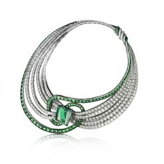 Adler Clef de Sol necklace, 18kt white gold set with 35ct of Emeralds and 99ct of Diamonds surrounding a 30ct Colombian Emerald