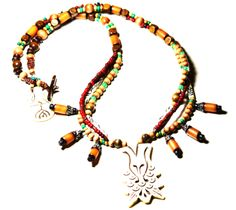White carved Goddess pendant necklace accented with wood, glass and gemstone bead mix. http://www.navahadijewelry.com/2016/12/white-carved-goddess-pendant-necklace.html