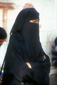 Smiling eyes in a burqa.