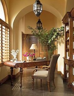 love the curve of this desk, the plantation shutters, the lanterns...pretty much everything!