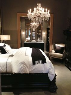 I would love to put a large mirror in our master bedroom like this one and do a pretty light fixture. #BeddingMasterBedroom
