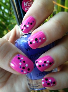 Pink manicure with polka dots.