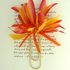 Ribbon and paper clips- cute.