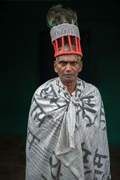 The makut, a peacock feather hat, is one of the most precious possessions of the Ramnami. Just like their body tattoos, the hat and alfi ramram, a big scarf, are covered with the name of their god Ram.