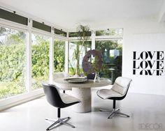 Courteney Cox's Malibu Home - large windows louvered transoms, concrete table