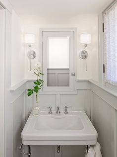 Gorgeous gray and white powder room. Love the light fixtures, light-filtering curtain, board