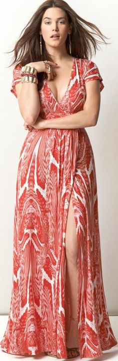 love the color and print on this. don't love the high slit and low cut neckline.
