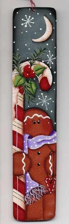 So much detail on this ornament! Colors are amazing together. Cute little gingerbread man holding a candycane that has snow and holly on top. Ive