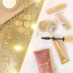 Gift Guide: For the woman who loves bling!  a) Eye Shere Liquid Eye Shadow (Gold & Peach shown), $17  b) 24K Gold Dust (Gold shown), $14 c) Longest Lash Mascara, $33  d) Golden Shimmer Face and Body Lotion, $32