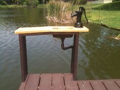 Custom fish cleaning table I made with stainless sink, hand pump, and cedar top. -Brannen Acor