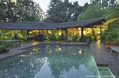 """""""Oakmont Residence"""" Exemplifying the California Ranch Style through its spacious plan, expansive windows and low gable roofline, Marmol Radziner added 3,000 square feet to the existing 6,000 square foot home, incorporating a new office, gym, and a studio quality theater.   Original Architect: Cliff May (1956)"""