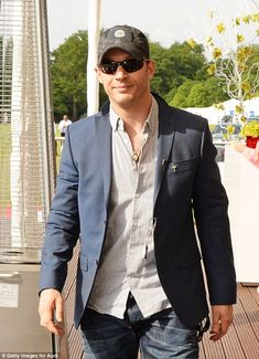 Casual chic: Tom wore a baseball hat for his entry to the polo match