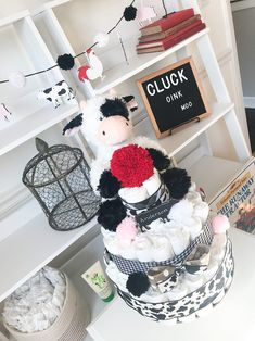 Oct 2019 - You need an adorable diaper cake for your Farm themed baby shower and we have the perfect decoration for you! Our cute cow diaper cake coordinates perfectly with our Cluck Oink Moo Hospital Door Hanger, Mommy to Be Pin and Farm Animal Banner. Cow Baby Showers, Baby Showers Juegos, Baby Boy Shower, Baby Shower Gifts, Fiesta Baby Shower, Baby Shower Parties, Baby Shower Themes, Baby Girl Themes, Cow Nursery