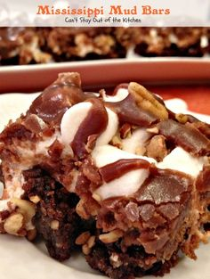 Mississippi Mud Bars ~  from PaulaDeen ... Brownies with pecans, marshmallows and chocolate.