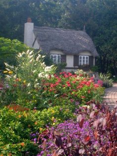 The gardens of Assiniboine Park include the English Garden with its Crofter's Cottage, possibly the world's most lovely tool storage shed pleasant paths and entranceway guard, known as the boy with the boot. #englishgardens #englishcottagegardens