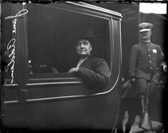 Portrait of Jane Addams, the founder of Hull House, sitting in an automobile in Chicago, Illinois. 1915