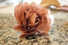 Coffee Filter Flower tutorial for wreaths, gift adornment, etc