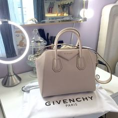 Givenchy Antigona Small Sugar Goatskin in Nude Givenchy Antigona Small Sugar Goatskin Satchel Bag—Nude. Sold out everywhere! Like-New, without tags. Comes with dust bag, shoulder strap, leather sample, & authenticity care card. Included a modeled picture for reference! Priced lower on other apps!NO TRADES Givenchy Bags