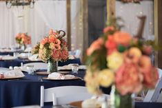 coral and yellow floral centerpiece on navy blue tablecloth-Pink and Blue Wedding-Cross Creek Ranch in Dover, FL - Photo: Corner House Photography- Orange Blossom Bride-Orlando Wedding Blog