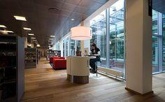Great floors, I like the gray shelving  -----   Kolding Library - service desk