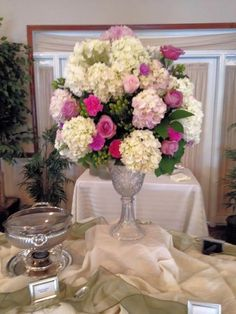 Large Arrangement Featuring Hydrangeas and Roses with bright green berry and leaf accents