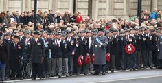 Procession: Veterans assemble on Whitehall this morning for the national Remembrance Sunday service at the Cenotaph