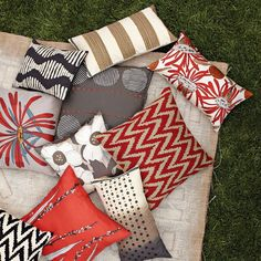 182395853632956841 Color scheme for living room with warm tones on a grey couch. Pillows available at West Elm.
