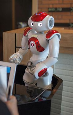 A robotic concierge handles guests' questions at the Strange Hotel.