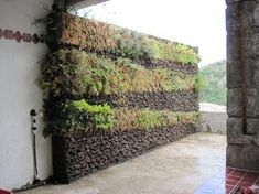 vertical garden, with gabion rock wall http://www.gabion1.com.au I probably wouldn't like a gabion wall as a landscaping feature unless it was like this.