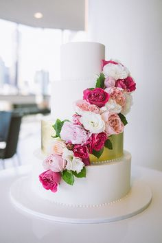Gold wedding cake with pink peonies