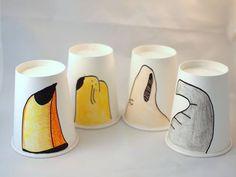 Manualidades con niños en vasos de papel dibujando picos, tromp...