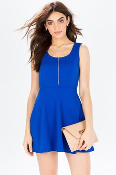 An easy-to-wear yet still unique fit & flare dress, featuring a geo-burst textured body, scoop neck with gold zipper, and sleeveless cut. Scoop back. Textured fabric. Finished edges. Curved seams. Looks great with wedges and a denim jacket! $24.50