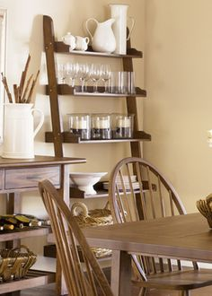 Leaning Bookcase Display in dining room (glasses, pitchers, etc)