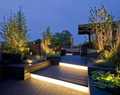 contemporary wooden deck design different levels and incorporated lighting