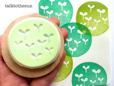 garden rubber stamp. hand carved rubber stamp. circle pattern stamp. green sprouts. mounted.