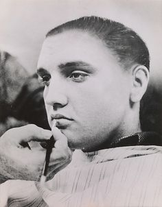 In 1957 the U.S. Army announced that Elvis Presley had been drafted for military service. To simulate what the pop idol would look like with the standard G.I. haircut, a retoucher at the United Press news agency used an airbrush to trim his trademark pompadour and sideburns, revealing a rather misshapen version of the future Private Presley.