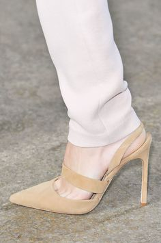 Pointed toes and high stiletto heels were still the mark of a great power pump. Spring '15's iterations come with ankle straps, slingbacks, too, and in every case, they're still a sign of classic womanly dressing.  Wes Gordon Spring 2015
