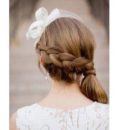 Idée coiffure de mariage : une tresse à l'envers sur le côté