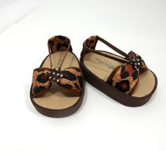 """Leopard prints sandals for your American Girl 18"""" dolls! I designed and handmade these sassy bow sandals for American Girls dolls, but they will accommodate the feet of other similar 18"""" dolls. These sandals are made of craft foam and ribbon. Each of these sandal comes with an elastic loop that gently hugs the doll's ankle. American Girl 18 Doll Shoes Sandals Leopard Prints by MegOrisDolls"""