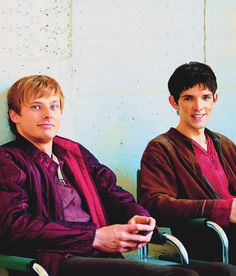 -Bradley James and Colin Morgan. // These two wear a lot of purple...