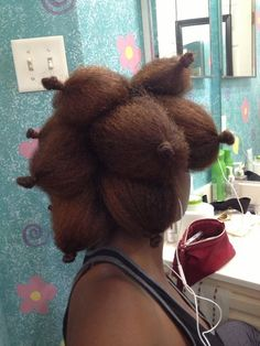 Adding curls to a blown out afro using bantu knots at the ends.