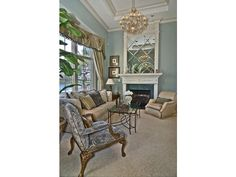Traditional blue formal living room with chandelier - Quail West - Naples, FL