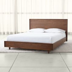 Shop Tate Queen Wood Bed. Designed by Blake Tovin, the Tate Queen Wood Bed is a Crate and Barrel exclusive.