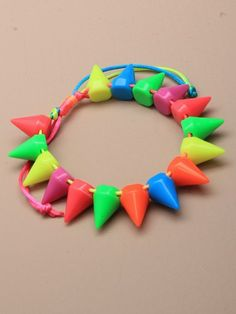 Bright spikey bracelet, available at;    http://www.incauk.com/search/?_skip=0&search=bracelets&all=1