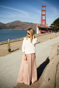 Love how she styled this blush maxi - pretty much have a matching one in my closet. Now I just need a nice cream sweater or spring-y top to go with!