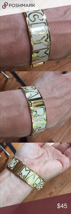 Marc Jacobs logo hinged gold and white bangle Good condition Marc Jacobs Jewelry Bracelets