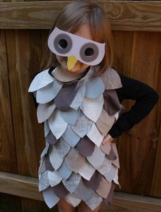 By Ellen Baker Still looking for a Halloween costume for your kiddo? Here's an easy way to turn a t-shirt into an owl costume in a couple of hours. If you don't have a sewing machine, you can simply glue the fabric feathers onto the costume with permanent fabric glue found at your local sewing shop or craft supply store. You can cut up old t-shirts or other old clothing for the feathers. So just cut and glue. Easy, right? I think this would also work pretty well for a wild thing cos...