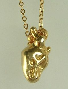 tired of cute heart pendants? i so want this.