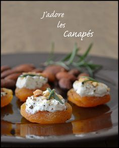 Oh, j'adore les canapés! These are apricot with goat cheese, black pepper, almonds and rosemary. Easy, delicious and healthy!